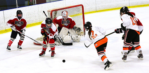ROB FOUNTAIN/STAFF PHOTO 11-23-2016<br /> Plattsburgh High's Hannah Glicksman (2) fires a shot at Beekmantown goaltender Taylor Laurin during a non-league girls' hockey game Tuesday at Ameri-Can North Sports Center.