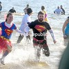 ROB FOUNTAIN/STAFF PHOTOS 11-14-2016<br /> Using their super powers, participants hurry back out of the water before freezing Sunday during the Annual Polar Plunge at the Plattsburgh City Beach. The event, which benefits the Special Olympics, included games, an eating contest, entertainment and more.