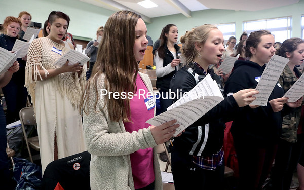 GABE DICKENS/P-R PHOTO 11-18-2016<br /> The women's chorus rehearses Friday afternoon for the New York State School Music Association's 2016 Zone 6 Area All-State Music Festival, which took place Saturday afternoon at Chazy Central Rural School. High school students from Clinton, Essex and Franklin counties participated in the annual festival, which also included performances by the mixed chorus, concert band and jazz ensemble featuring guest conductors from across the state.