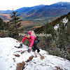JOANNE KENNEDY/P-R PHOTO 11-7-2016<br /> ​Peru resident Lori Clark ascends an icy section of the trail while hiking Big Slide Mountain. Besides the treat of beautiful fall/winter views, Clark encountered many icy and snow-covered sections during her day hike. Many of the Adirondack High Peaks have full winter conditions that warrant some type of traction for boots, along with extra warm clothing, food and water. To find Big Slide, follow Adirondack Street/Johns Brook Lane to the Garden parking area. There is a $7 fee to park.