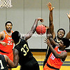 ROB FOUNTAIN/STAFF PHOTO 11-7-2016<br /> Clinton's Rayquan Brandford (22) looks on as teammate Josh Harriott (10) gets stuffed by Herkimer's Todd Spottswood (33) Sunday during men's basketball action in Plattsburgh.