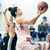 Plattsburgh State's Frannie Merkel splits Southern Vermont College defenders for an easy layup during the opening round of the Cardinal Classic at Memorial Hall Saturday afternoon. The Cardinals move onto the championship match Sunday by defeating the Mountaineers 80-38.<br /> <br /> GABE DICKENS/P-R PHOTO 11-18-2016