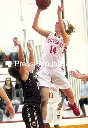 ROB FOUNTAIN/STAFF PHOTO 11-15-2016<br /> Plattsburgh State's Olivia Souky (14) goes up over Norwich's Shyann Joster Tuesday at Memorial Hall in Plattsburgh.