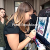 GABE DICKENS/P-R PHOTO 11-7-2016<br /> Clinton Community College student Lacey Tedford of Champlain watches as Caitlyn DeGano of New Jersey creates a custom airbrushed tote bag during a recent event sponsored by the CCC College Association.