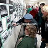 GABE DICKENS/P-R PHOTOS 11-6-2016<br /> Event attendees and former school members look at old class photos during the recent 100 Years of Excellence celebration in Chazy.