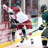 GABE DICKENS/P-R PHOTO 11-20-2016<br /> Plattsburgh State's Kyle Hall checks Oswego's Joey Rutkowski into the boards during Saturday's SUNYAC men's hockey game at Stafford Ice Arena. The Lakers downed the Cardinals 4-1.