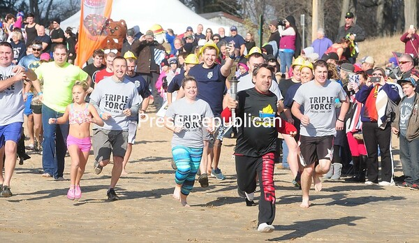 Participants run toward the water after the horn sounded the start of the Annual Polar Plunge.<br /> ROB FOUNTAIN/STAFF PHOTO 11-14-2016