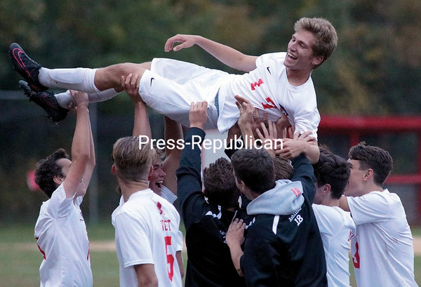 GABE DICKENS/P-R PHOTO 10-14-2016 The Beekmantown Eagles hoist into the air teammate Ryan Brienza, who scored a goal, to celebrate their 5-2 victory over the Saranac Lake Red Storm at Beekmantown Recreation Park Thursday.