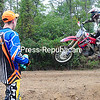 ROB FOUNTAIN/STAFF PHOTO 10-4-2016<br /> Colden Lawrence watches riders sail over one of the jumps during the 27th annual Doug Powers Motocross Invitational in Plattsburgh Sunday. Proceeds benefited Gabby Lincoln, who is in chronic rejection of a double lung transplant. Hope for her is an experimental drug to slow the process, and she flies to Boston frequently for care.