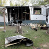 GABE DICKENS/P-R PHOTO 10-1-2016<br /> Fire gutted a mobile home at 80 Pleasant St. Lot 9 in Peru Thursday night. Marc Chick and his girlfriend, Gale McElwey, lived there with his daughter, Alexandra, and her son, Devin.