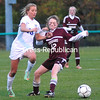 ROB FOUNTAIN/STAFF PHOTO 10-23-2016<br /> Northeastern Clinton's Caitlyn Houghton (12) and Peru's Anna Mitchell (16) battle for a loose ball during a Section VII Class B girls' soccer semifinal in Chazy.