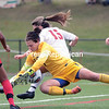 GABE DICKENS/P-R PHOTO 10-1-2016<br /> Plattsburgh State goalkeeper Nichole Gibson tangles with Cortland defender Biz LaTuso to secure a loose ball during Saturday's SUNYAC game at the Field House. The Cardinals defeated the Red Dragons 2-0.