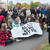 ROB FOUNTAIN/STAFF PHOTO 10-27-2016<br /> SUNY Plattsburgh students sign a Black Lives Matter banner while gathering for a photo at Hawkins Hall Wednesday during the Teach-In at SUNY Plattsburgh.