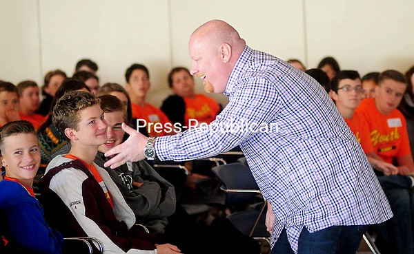 ROB FOUNTAIN/STAFF PHOTO 10-14-2016 Tom Bull, motivational speaker and behavior support counselor at Peru Central School, gets kids energized about becoming good students during the recent Youth Empowerment Summit in the SUNY Plattsburgh Angell Center.