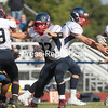 GABE DICKENS/P-R PHOTO 10-2-2016<br /> AuSable Valley quarterback Dalton McDonald hands the ball off to teammate Matt Pray as the offensive line puts up blocks on Peru's defense during Saturday's Champlain Valley Athletic Conference football game at Peru Central School.