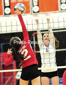 Saranac Lake's Alivia Sapone (2) looks to get the ball past Plattsburgh High's Katie Kavanaugh (5) Tuesday during Champlain Valley Athletic Conference volleyball action in Plattsburgh.  ROB FOUNTAIN/STAFF PHOTO 10-14-2016
