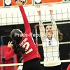 Saranac Lake's Alivia Sapone (2) looks to get the ball past Plattsburgh High's Katie Kavanaugh (5) Tuesday during Champlain Valley Athletic Conference volleyball action in Plattsburgh. <br /> ROB FOUNTAIN/STAFF PHOTO 10-14-2016