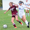 ROB FOUNTAIN/STAFF PHOTO 10-4-2016<br /> Northeastern Clinton's Elizabeth Roberts (7) and Peru's Sam Spear (3) battle for possession of a loose ball during a girls' Northern Soccer League game Monday in Peru.