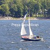 ROB FOUNTAIN/STAFF PHOTO 10-2-2016<br /> Pushed by a steady, strong breeze, a sailboat crashes through the waves of Lake Champlain near the ferry dock on Cumberland Head in Plattsburgh. Mild temperatures this week have extended the sailing season.