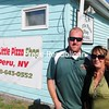 ROB FOUNTAIN/STAFF PHOTOs 10-2-2016<br /> Amy and Todd Clowney, the new owners of The Little Pizza Shop on Lapham Mills Road in the Town of Peru, pose for a photo outside the business.