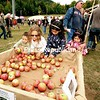 Children select apples at Whiteface Mountain Oktoberfest in Wilmington over the weekend. The two-day, Bavarian-style celebration, featuring authentic music, dancing, food and beer, marked its 25th anniversary this year. <br /> <br /> JACK LADUKE/P-R PHOTO 10-3-2016