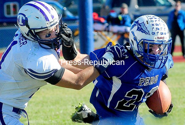 ROB FOUNTAIN/STAFF PHOTO 10-16-2016<br /> Peru's John Gallo (23) looks to shake off Ticonderoga's Justyn Granger (11) Saturday during football action in Peru.