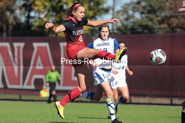 GABE DICKENS/P-R PHOTO 10-16-2016 Plattsburgh State's Anissa Hartmann launches a shot on net during the Cardinal's SUNYAC match against Fredonia at the Field House Athletic Complex Saturday afternoon.