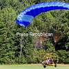 "ALVIN REINER/P-R PHOTO 10-1-2016<br /> Rob Sedgwick lands his powered parachute at Marcy Field in Keene Valley with passenger Janet Burl of Burke. ""Now I know what an eagle feels like,"" said Burl, a vendor at the Keene Farmers Market who had a stroke last year and walks with a cane. ""I am putting in my order in my next life to be an eagle. This was easier to travel than by walking."" Sedgwick lives in Rochester, Vt. A powered parachute, which is at the whim of the weather and wind, generally flies best in the mornings and evenings. They hold around 15 gallons of gas and can stay aloft about three hours."