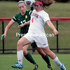 Plattsburgh State's Sarah Bonner competes for the ball with Oswego's Samantha Shubert during Friday's State University of New York Athletic Conference match at the Field House Athletic Complex. The Cardinals ousted the Lakers 1-0 in overtime.<br /> GABE DICKENS/P-R PHOTO 10-2-2016