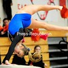 ROB FOUNTAIN/STAFF PHOTO 10-16-2016<br /> Peru's Delaney Brown sails over the vault Saturday during the Section VII Gymnastics Championships at Plattsburgh High School. Brown won the overall and helped Peru take home the championship.