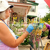 JACK LADUKE/P-R PHOTO 8-23-2016<br /> Artist Cheryl Simeone of Three Mile Bay paints a colorful scene at the Pink House in Saranac Lake during the Plein Air Festival. Pink House owner Chris Winters tends to her flowers in the background. About seventy artists from across the United States and Canada showed up for the annual event, which ran from August 15 to 20.