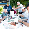 GABE DICKENS/P-R PHOTO 8-24-2016<br /> Volunteers and veterans with North Country Honor Flight count several thousand dollars in coins and bills collected during the organization's recent street drive along City Hall Place and also near Buffalo Wild Wings in Plattsburgh. The goal of $15,000 will help fund the next Honor Flight to Washington, D.C., for 14 military veterans and their guardians, along with medical staff. The next trip is scheduled for Sept. 10.