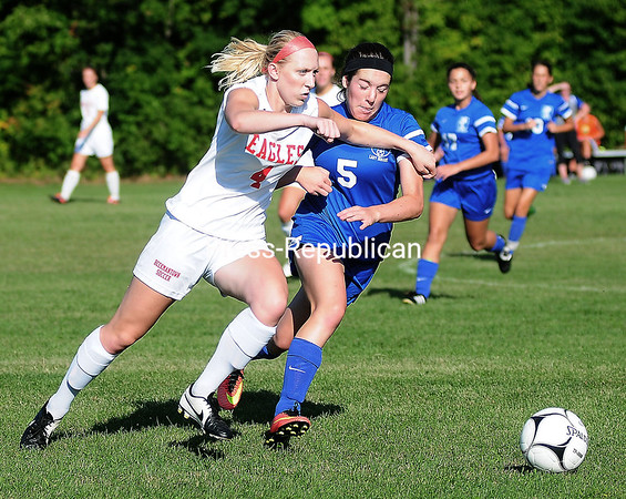 ROB FOUNTAIN/STAFF PHOTO 9-8-2016<br /> Beekmantown's Kenna Guynup (4) takes the ball up field against Peru's Sierra Bouchard (5) Wednesday during girl's soccer action in Beekmantown.