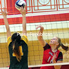 ROB FOUNTAIN/STAFF PHOTO 9-28-2016<br /> Northern Adirondack's Chloe Smith (11) tries to block a shot by Beekmantown's Bailee Mull (16) Tuesday during Champlain Valley Athletic Conference volleyball in Beekmantown.