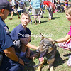 """ALVIN REINER/P-R PHOTO 8-24-2016<br /> State Trooper Ismael Ramos discusses his German shepherd, Rosie, with Sarah Gibson and Cameron Armstrong, both from Lewis. During an exhibition earlier at the fourth-annual North Country SPCA Open House, Rosie found potential explosives, searched for a missing person and protected Ramos from an attacker portrayed by State Police Capt. John Tibbetts. The recent event featured crafts, food, free pet adoptions, microchip implanting, raffles and a golf ball drop. The SPCA is located at 7700 Route 9N east of Elizabethtown. For additional information, call 873-5000 or go to  <a href=""""http://www.ncspca.com"""">http://www.ncspca.com</a>."""