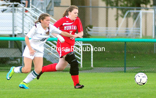 ROB FOUNTAIN/STAFF PHOTO 9-12-2016<br /> Chazy's Natalie Pombrio (16) and Moriah's Carly Newton (7) chase after a loose ball during girls' Northern Soccer League play Monday in Chazy.