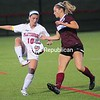 Plattsburgh's Madeline Saccocio (10) tries getting the ball past Union's Krista Erlandson (2) Tuesday during women's soccer action at the SUNY Plattsburgh Field House.<br /> ROB FOUNTAIN/STAFF PHOTO  9-7-2016