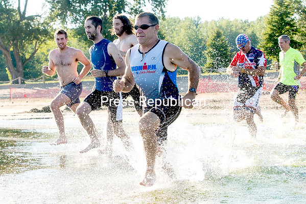 GABE DICKENS/P-R PHOTO 8-24-2016 Athletes take to the water for what should have been a 200-yard swim but turned out to be more like a 200-yard wade due to the low water on Lake Champlain during the Itri mini triathlon at Plattsburgh City Beach on a recent evening. The last remaining triathlons of the season take place this Thursday and Thursday, Sept. 1, with registration at 5:30 p.m and a 6 p.m. race time. The cost is $10.