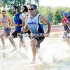 GABE DICKENS/P-R PHOTO 8-24-2016<br /> Athletes take to the water for what should have been a 200-yard swim but turned out to be more like a 200-yard wade due to the low water on Lake Champlain during the Itri mini triathlon at Plattsburgh City Beach on a recent evening. The last remaining triathlons of the season take place this Thursday and Thursday, Sept. 1, with registration at 5:30 p.m and a 6 p.m. race time. The cost is $10.