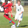 ROB FOUNTAIN/STAFF PHOTO 9-14-2016<br /> Seton Catholic's Foster Ovious (4) moves the ball by Willsboro's Mouhamadou MBacke (2) Tuesday during Northern Soccer League action in Plattsburgh.