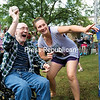 GABE DICKENS/P-R PHOTO 8-22-2016<br /> Certified Nursing Assistant Kerina Kent points Plattsburgh Rehabilitation and Nursing Center resident Larry Hewson toward the target on the dunk tank as he fires a ball during the center's annual summer carnival Friday afternoon. The Plattsburgh Rehabilitation and Nursing Center was formerly Evergreen Valley Nursing Home.