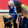 JULIAN BREYETTE/PHOTO 9-29-2016<br /> Lions Club International President Bob Corlew pets Pepper who is handled by Plattsburgh Lions President Lauren Tyler.