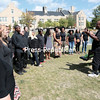 "GABE DICKENS/P-R PHOTO 9-11-2016<br /> Dr. Dexter Criss conducts the Plattsburgh State Gospel Choir during their rendition of ""God Bless America"" to close out a brief 9/11 remembrance ceremony at Hawkins Pond on campus Friday afternoon. Sunday is the 15th anniversary of the terrorist attacks."