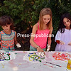 JOANNE KENNEDY/P-R PHOTO 8-24-2016<br /> Tanya Roark (left), Lily Badger (center) and Evie Badger have fun creating wall art using shaving cream and paint at the Peru Free Library Art Camp. The finished pieces will be on display in the library. Librarian Becky Pace said the four-week free camp has been a popular event this summer.