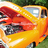 """ROB FOUNTAIN/STAFF PHOTO 8-24-2016<br /> Julio Rodriguez holds up his cousin Camilo Rodriguez to look inside """"The Pumpkin,"""" a 1950 Chevy Pro-tour Street Rod, Sunday during the Antique/Classic Car Show and Craft Show at St. Patrick's Church in Rouses Point. Proceeds from the event benefit the church."""