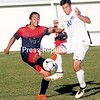 ROB FOUNTAIN/STAFF PHOTO 9-29-2016<br /> AuSable Valley's Desmond Fout (14) and Peru's Justin LaPorte (20) battle for the ball Wednesday during boys' NSL action in Peru.