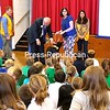 BRYAN MOORE/PHOTO 9-29-2016<br /> Lions Club International President Bob Corlew pets Pepper, the mascot of the Plattsburgh Lions Club, during a visit to Seton Academy in Plattsburgh on Wednesday. He is joined by Plattsburgh Lion Walt Williams, club treasurer (from left); Suzanne Moore, the blind pup's seeing-eye person; and Plattsburgh Lions President Lauren Tyler. The service organization's top leader has not visited the area since 1972.