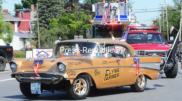 ROB FOUNTAIN/STAFF PHOTO 9-5-2016<br /> The Flying Farmer cruises around the corner of Route 11 and Route 22 Sunday during the 58th-Annual Mooers Labor Day Celebration.