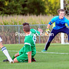 ROB FOUNTAIN/STAFF PHOTO 9-20-2016<br /> Seton Catholic goalkeeper Dawson Pellerin defends a shot from Chazy's Tristan Conners (3), with Seton Catholic's Alex Sharon (13) looking on, in boys' Northern Soccer League play Tuesday.