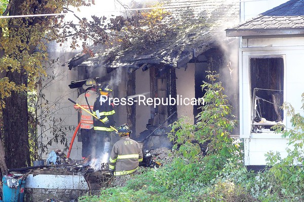 Smoke pours out of the house at 3509 Route 3 in the Town of Saranac as firefighters work to extinguish a blaze there Tuesday afternoon.<br /> ROB FOUNTAIN/STAFF PHOTO  9-7-2016